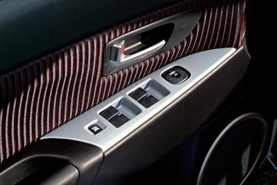 Door switch panel garnish, alloy look